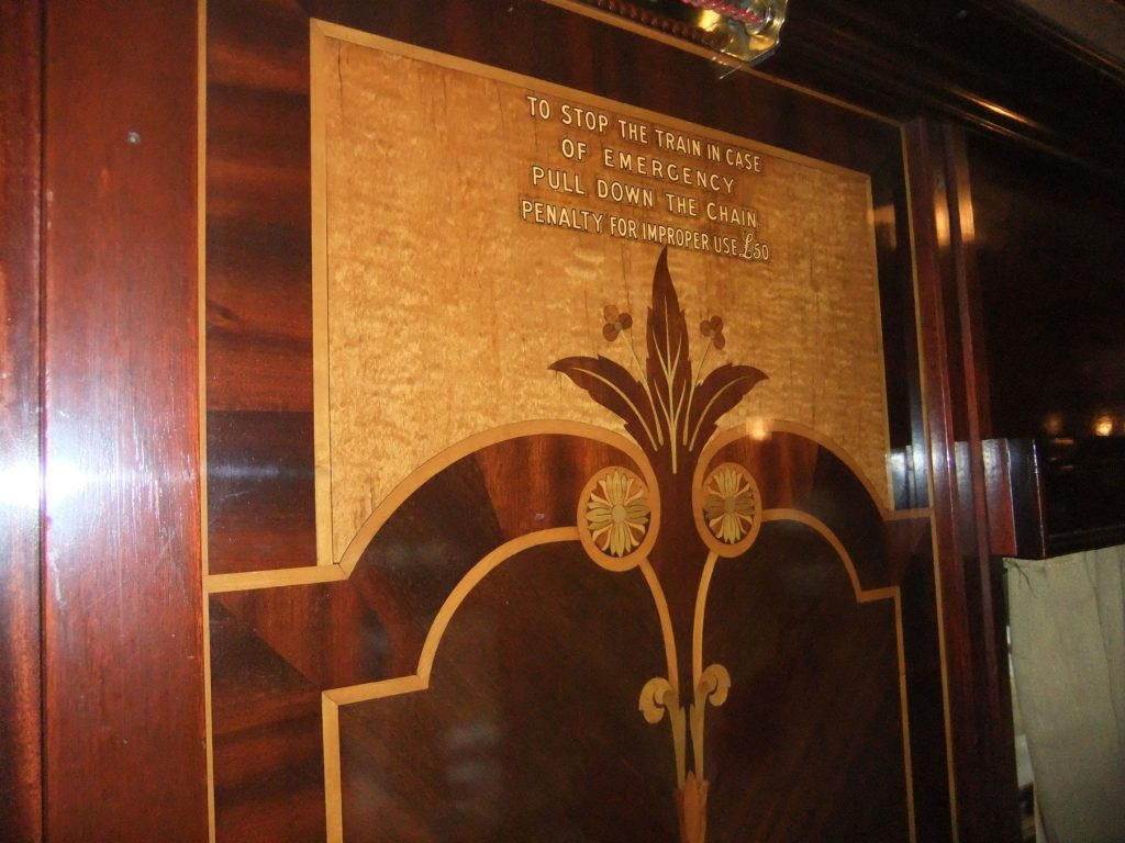 The marquetry. Oh, the marquetry. And an instruction about what to do in case of an unexpected emergency...