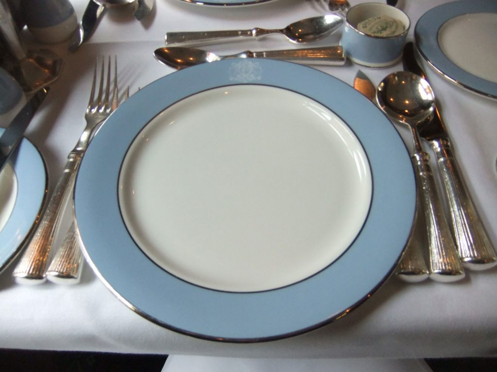 The beautiful place setting. The crest was always at the top, and the knives and forks and crystal glasses were ALWAYS rattling as the train moved. Pouring a drink was a difficult activity!